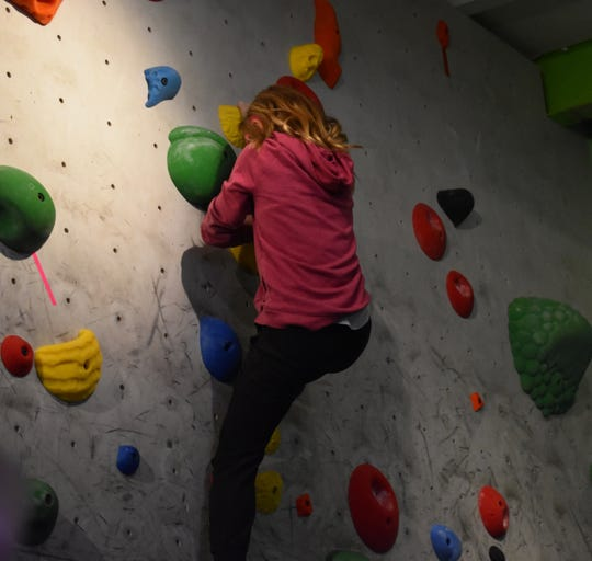 Olivia Chenoweth ascends the climbing wall at the Hi-Line Climbing Center. The Rocktober competition drew 40 to 50 children and more than a dozen adults.