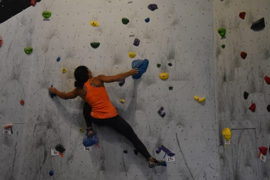 Youth Climbing Club instructor Maiza Lima completes one of her climbs Saturday at the Rocktober climbing event at the Hi-Line Climbing Center in Great Falls.