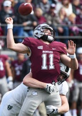 Montana quarterback Dalton Sneed (11) releases the ball as he is hit by Portland State defensive end Noah Yunker (53) during the first half of an NCAA college football game Saturday, Oct. 6, 2018, in Missoula, Mont. (Colter Peterson/The Missoulian via AP)