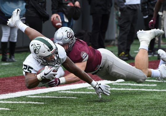 Portland State running back Sirgeo Hoffman (25) extends the ball for a few extra yards as he is tackled by Montana linebacker Dante Olson (33) during the first half of an NCAA college football game Saturday, Oct. 6, 2018, in Missoula, Mont. (Colter Peterson/The Missoulian via AP)