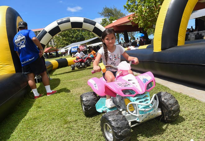 Children drive through a Power Wheels obstacle course during the Guam Contractors Association Family Day Picnic at the Gov. Joseph Flores Memorial Park, Oct. 7, 2018.