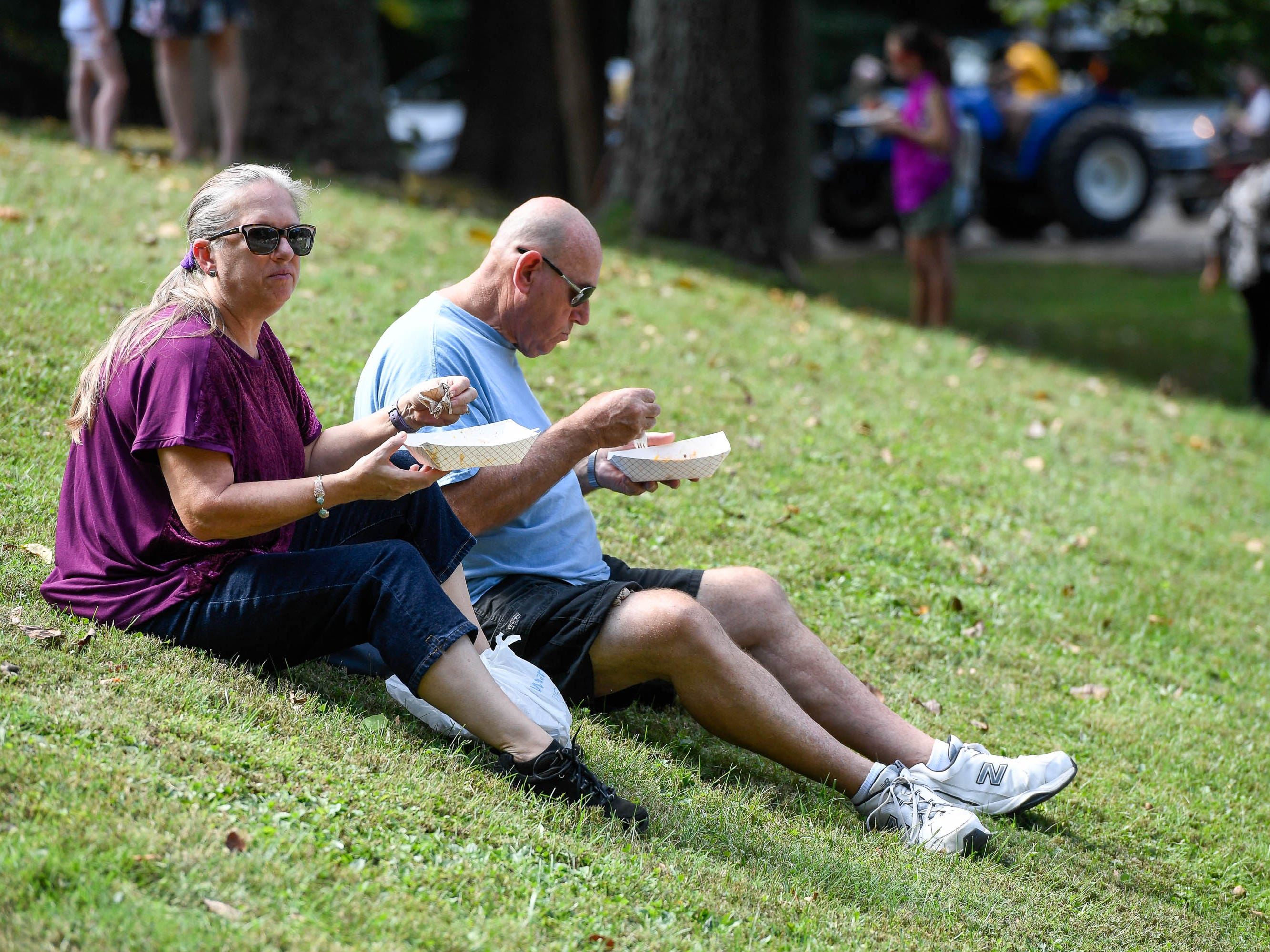 Linda and Chuck Bryant from Evansville enjoy lunch on the lawn at the Henderson Lions Arts and Crafts festival held at Audubon State Park Saturday, October 6, 2018.