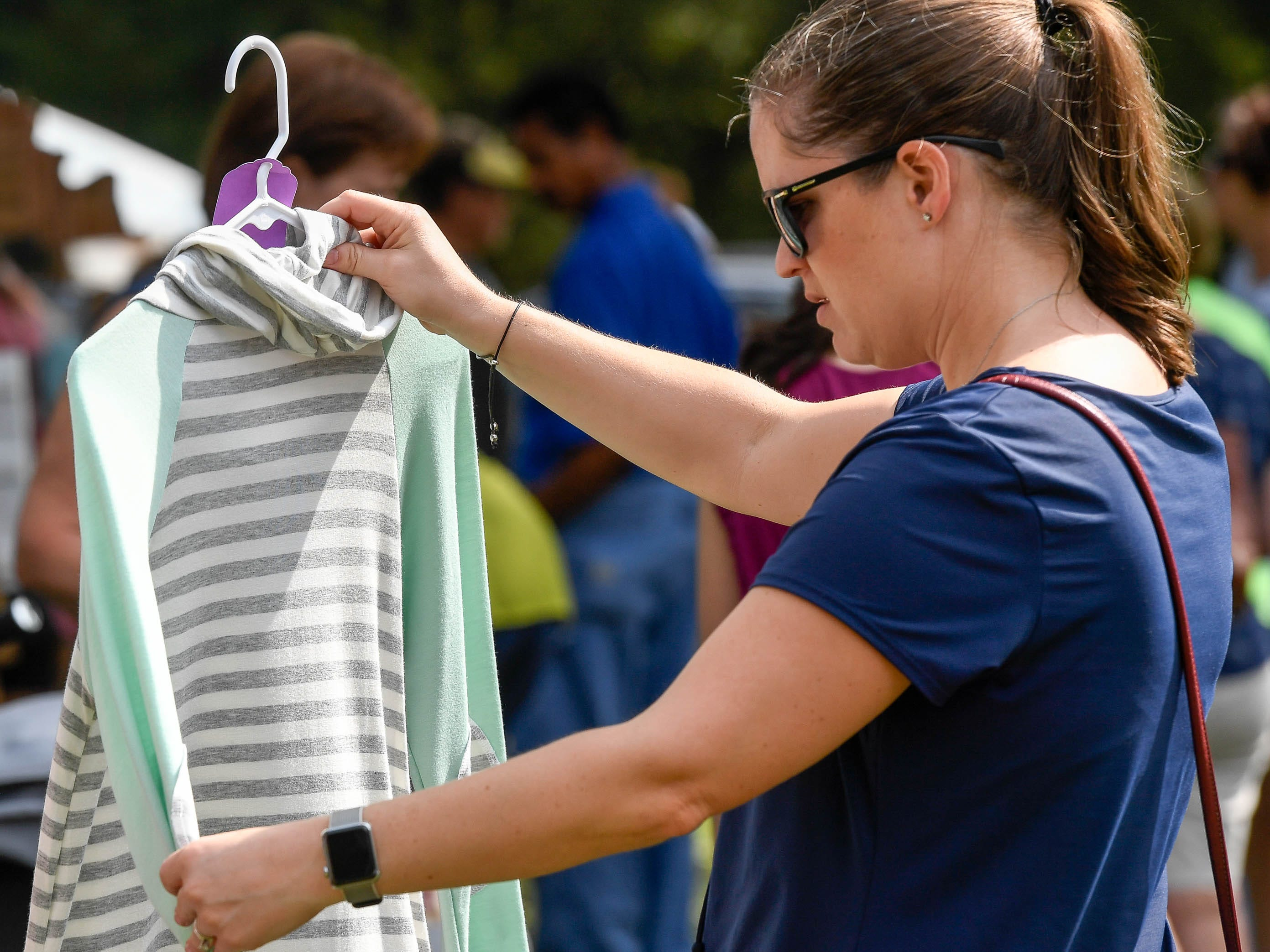 Holly Gavin, Henderson, browses through some clothing items at the Henderson Lions Arts and Crafts festival held at Audubon State Park Saturday, October 6, 2018.