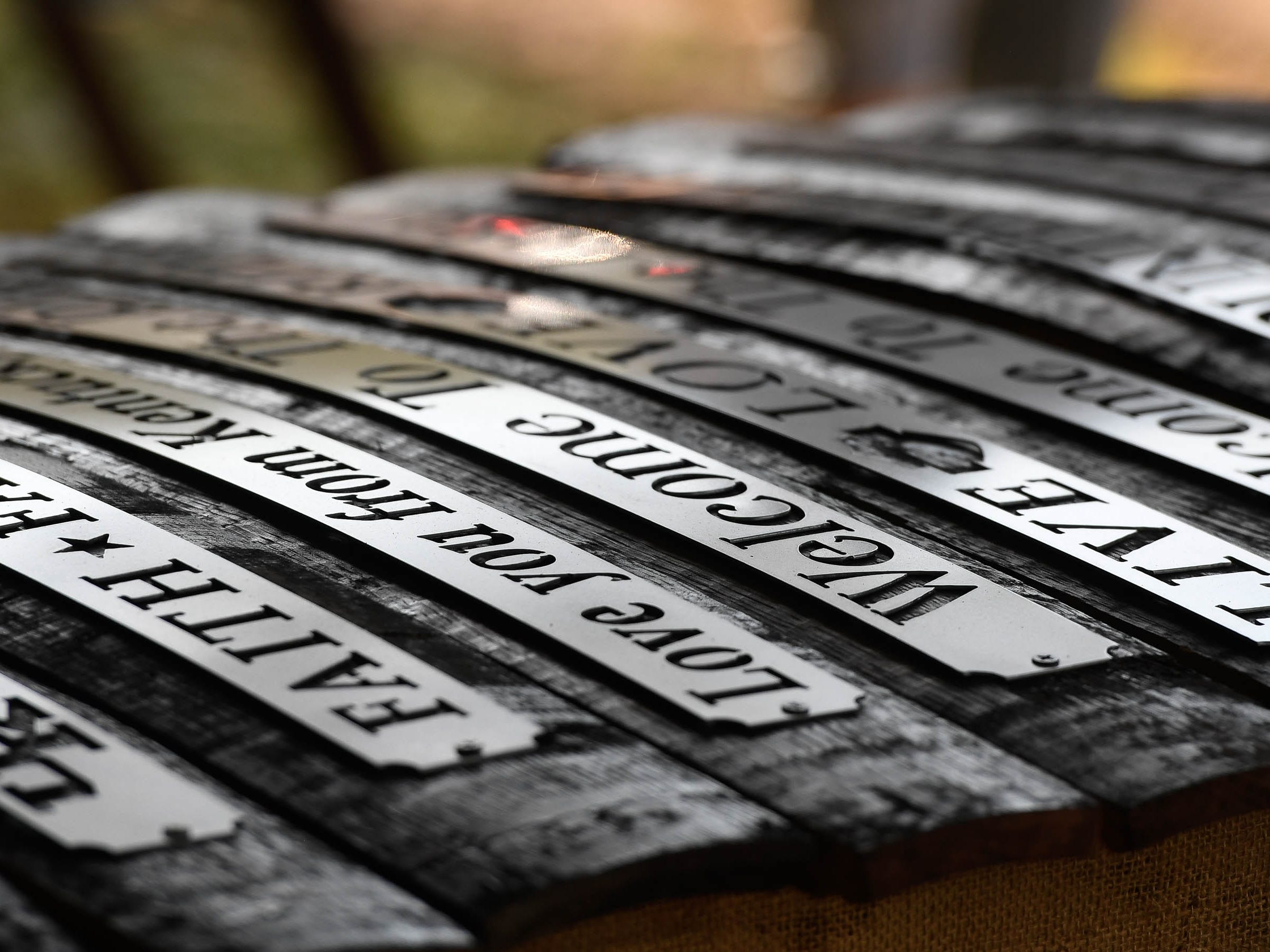 Welcome greetings and wise words cut out of steel and mounted to whiskey barrel staves for sale at the Henderson Lions Arts and Crafts festival held at Audubon State Park Saturday. The event, with nearly 100 vendors selling everything from seasonal florals to iron work, continues Sunday 10 a.m. to 4 p.m. October 6, 2018.