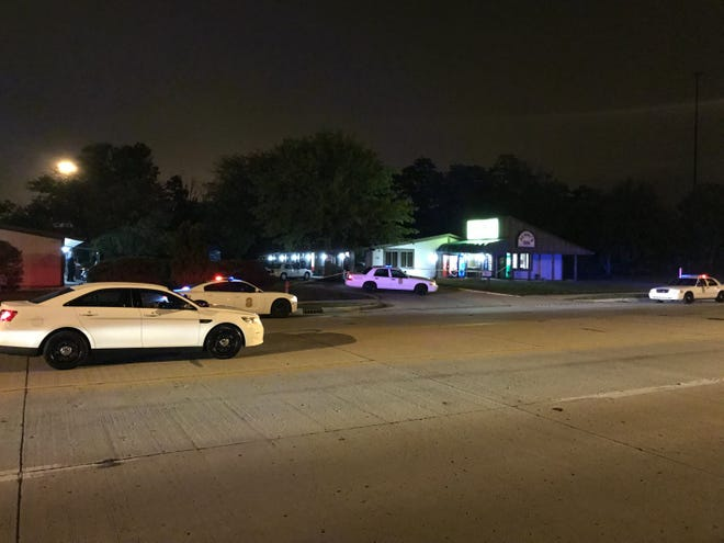 Police investigate a killing Sunday at the Always Inn, in the  7000 block of East 21st Street.