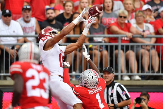 COLUMBUS, OH - OCTOBER 6:  Nick Westbrook #15 of the Indiana Hoosiers catches a 19-yard touchdown pass over Jeffrey Okudah #1 of the Ohio State Buckeyes in the second quarter at Ohio Stadium on October 6, 2018 in Columbus, Ohio.  (Photo by Jamie Sabau/Getty Images)