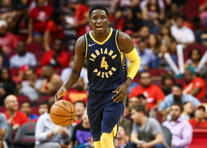 Oct 4, 2018; Houston, TX, USA; Indiana Pacers guard Victor Oladipo (4) dribbles the ball during the third quarter against the Houston Rockets at Toyota Center. Mandatory Credit: Troy Taormina-USA TODAY Sports