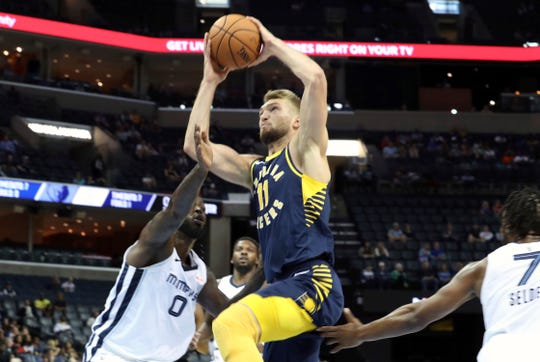 Indiana Pacers Domantas Sabonis (11) goes up for a basket guarded by Memphis Grizzlies JaMychal Green in the first half of a preseason NBA basketball game Saturday, Oct. 6, 2018, in Memphis, Tenn. (AP Photo/Karen Pulfer Focht)