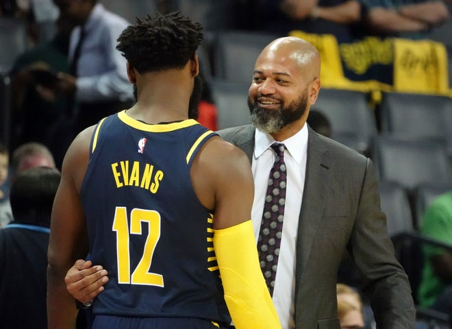 Memphis Grizzlies Coach J. B. Bickerstaff greets his former player Indiana Pacers Tyreke Evans (12) during a delay prior to the start of the first half of a preseason NBA basketball game Saturday, Oct. 6, 2018, in Memphis, Tenn.