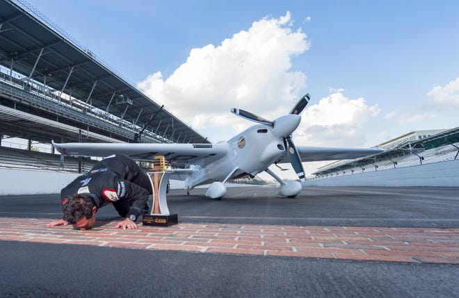 Team Goulian pilot Michael Goulian of the United States completes the tradition of kissing the yard of bricks at the historic Indianapolis Motor Speedway after winning the Master Class race. Fourteen pilots competed Sunday, Oct. 7, 2018 at the Indianapolis Motor Speedway in the Red Bull Air Race World Championship.