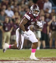 Mississippi State's Kylin Hill (8) carries for a gain in the first half. Mississippi State and Auburn played in an SEC college football game on Saturday, October 6, 2018, in Starkville.