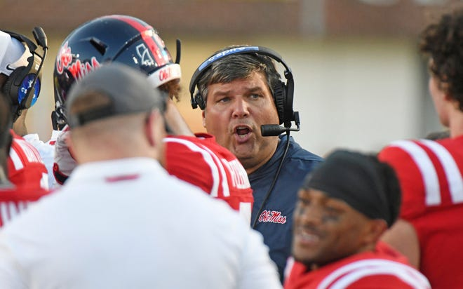 Ole Miss head coach Matt Luke talks to players during a timeout in the second half of an NCAA college football game against Louisiana Monroe in Oxford, Miss., Saturday, Oct. 6, 2018. Mississippi won 70-21. (AP Photo/Thomas Graning)