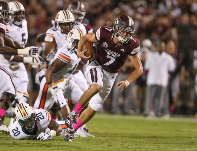 Mississippi State's Nick Fitzgerald (7) breaks free from Auburn's Jeremiah Dinson (20). Mississippi State and Auburn played in an SEC college football game on Saturday, October 6, 2018, in Starkville.