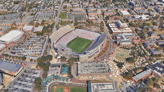"Google Earth image of Jordan-Hare Stadium on the campus of Auburn University in Auburn, Ala. Named for Ralph ""Shug"" Jordan, who owns the most wins in school history, and Cliff Hare, a member of Auburn's first football team, former Dean of the university's School of Chemistry, It seats 87,451."