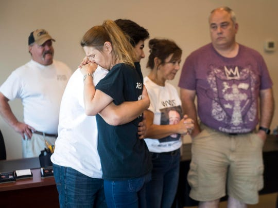 Janet Hitch hugs Anthony Ragone after seeing her son's car for the first time after it was rebuilt from the accident that killed him in 2014. Ragone is a car enthusiast like Hitch's son Jake Jennings and helped rebuild the Nissan Skyline along with many of Jennings' friends.