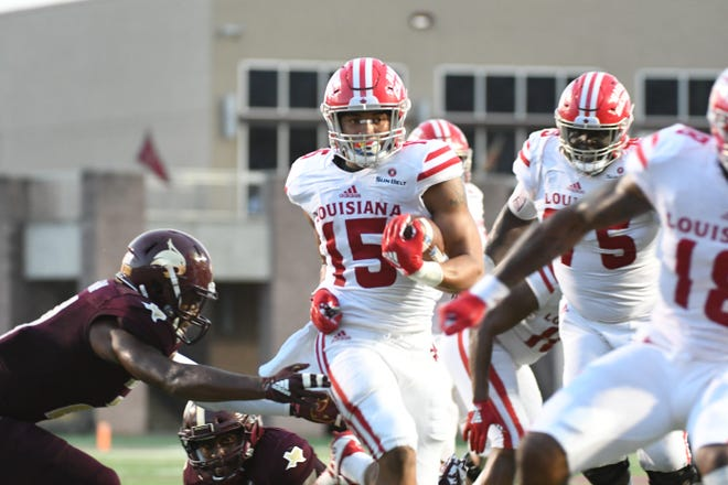 UL running back Elijah Mitchell (15) rushes for some of his 191 yards against Texas State on Saturday.