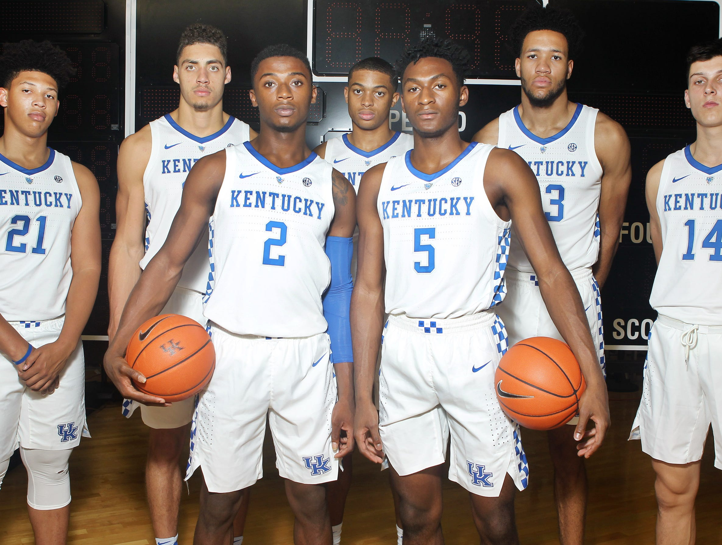 Kentucky newcomers (from left) Zan Payne (21), Reid Travis (22), Ashton Hagans (2), Keldon Johnson (3), Immanuel Quickley (5), EJ Montgomery (23) and Tyler Herro (14) pose during the teams picture day in Memorial Coliseum on campus. Sep. 20, 2018