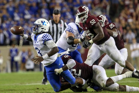 Oct 6, 2018; College Station, TX, USA; Kentucky Wildcats quarterback Terry Wilson (3) attempts to get rid of the ball as he is tackled by Texas A&M Aggies linebacker Otaro Alaka (42) during the fourth quarter at Kyle Field. Mandatory Credit: John Glaser-USA TODAY Sports