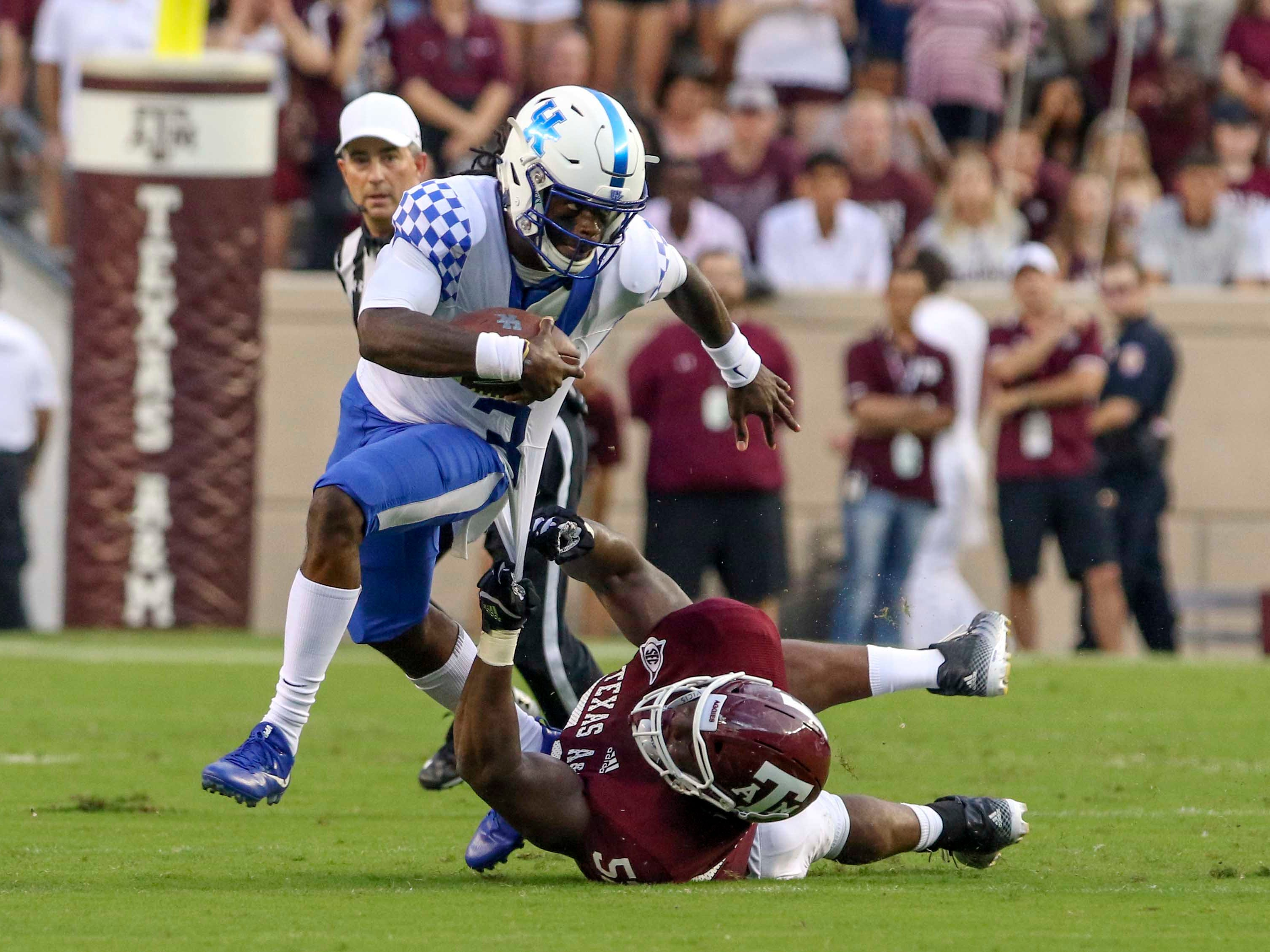 Oct 6, 2018; College Station, TX, USA; Texas A&M Aggies defensive lineman Justin Madubuike (52) grabs on to Kentucky Wildcats quarterback Terry Wilson (3) during the first quarter at Kyle Field.