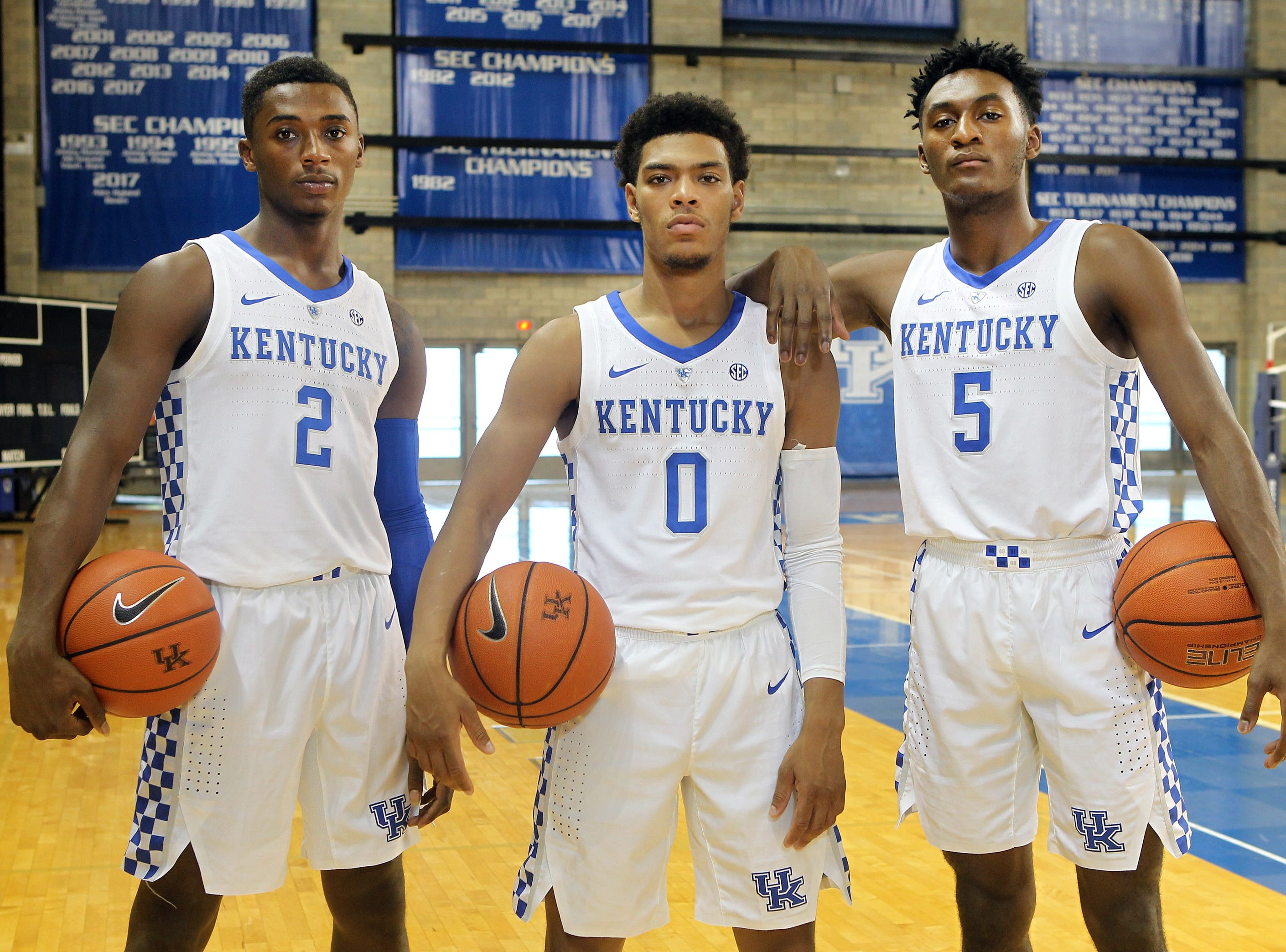 Kentucky point guards Ashton Hagans (2), Quade Green (0) and Immanuel Quickley (5) pose during the teams picture day in Memorial Coliseum on campus. Sep. 20, 2018