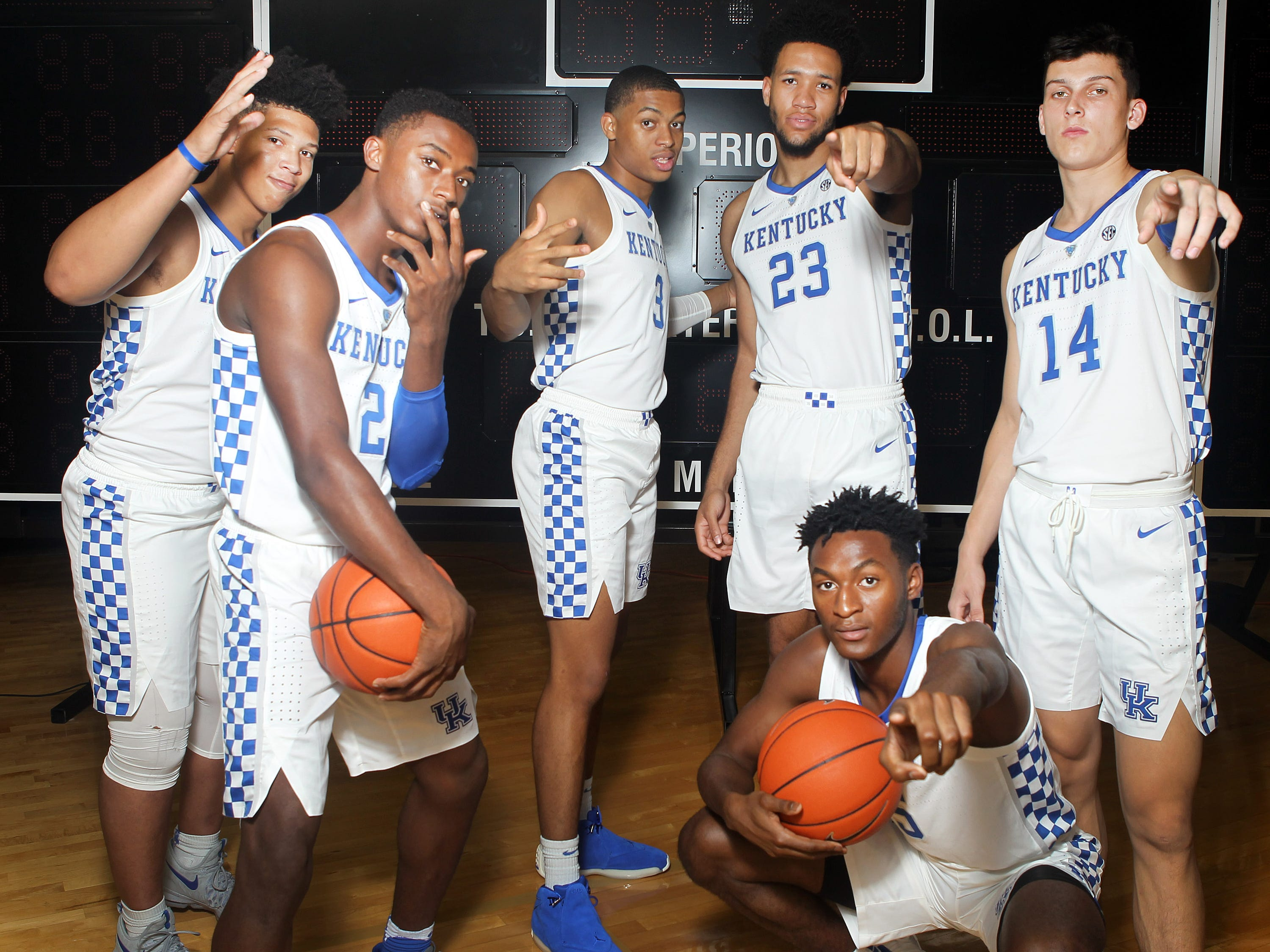 Kentucky freshmen (from left) Zan Payne (21), Ashton Hagans (2), Keldon Johnson (3), EJ Montgomery (23), Immanuel Quickley (5), and Tyler Herro (14) pose during the teams picture day in Memorial Coliseum on campus. Sep. 20, 2018