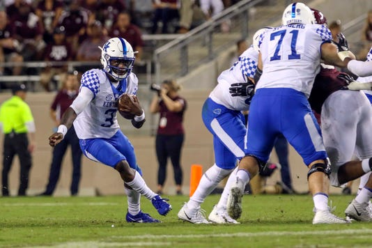 Terry Wilson scrambles in Kentucky football game against Texas A&M