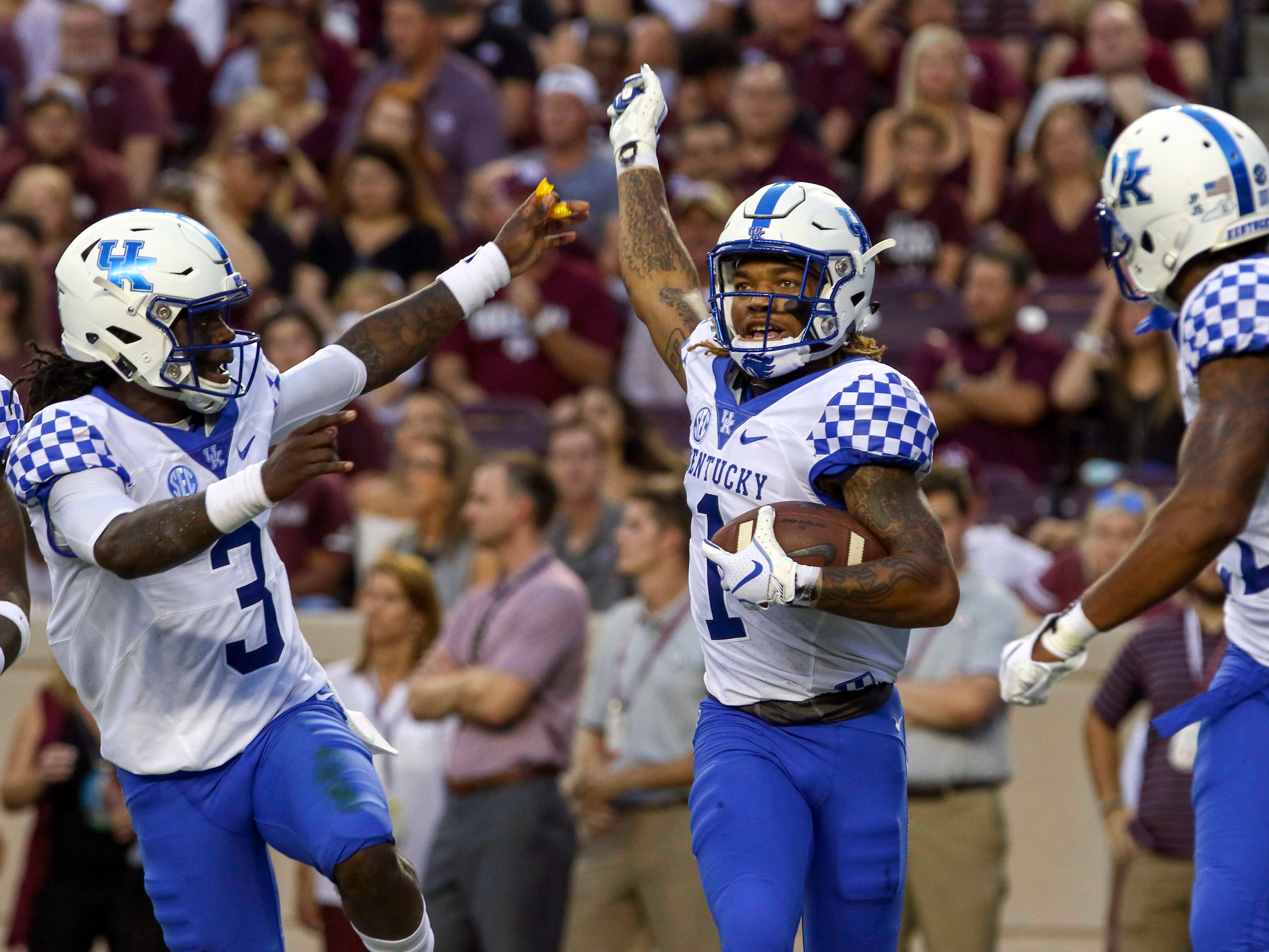 Oct 6, 2018; College Station, TX, USA; Kentucky Wildcats wide receiver Lynn Bowden Jr. (1) celebrates a touchdown with quarterback Terry Wilson (3) and wide receiver Tavin Richardson (11) during the first quarter against the Texas A&M Aggies at Kyle Field.