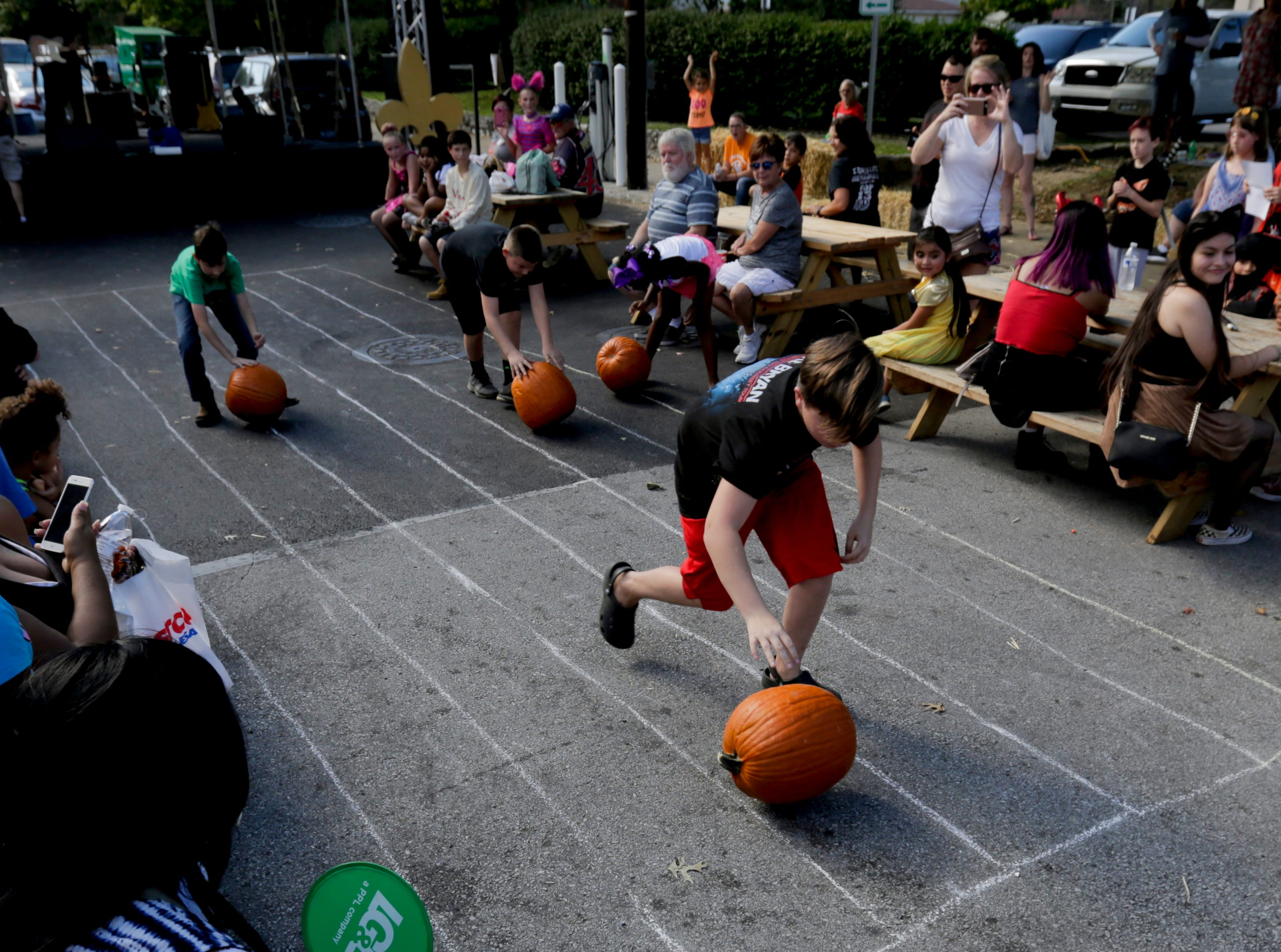 A pumpkin rolling contest at the 2018 Halloween Festival. 