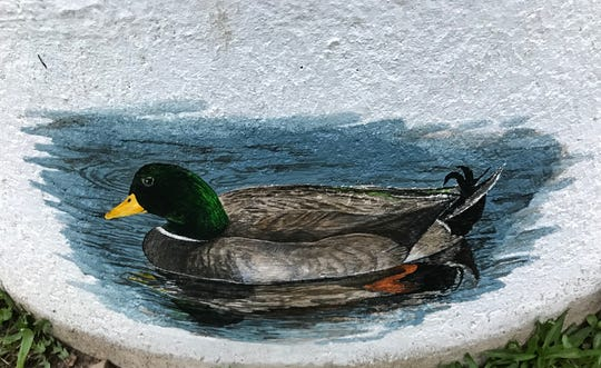 A wildlife painting of a mallard is part of a mural hobby artist Dan Wiles is creating on a concrete cistern at Mill Pointe Park in Eaton Rapids.
