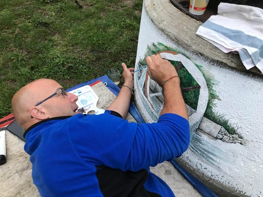Dan Wiles, an Eaton Rapids resident and hobby artist, is painting a mural on a concrete cistern at Mill Pointe Park along the Grand River. The artwork is just one of several public art projects underway in the community.