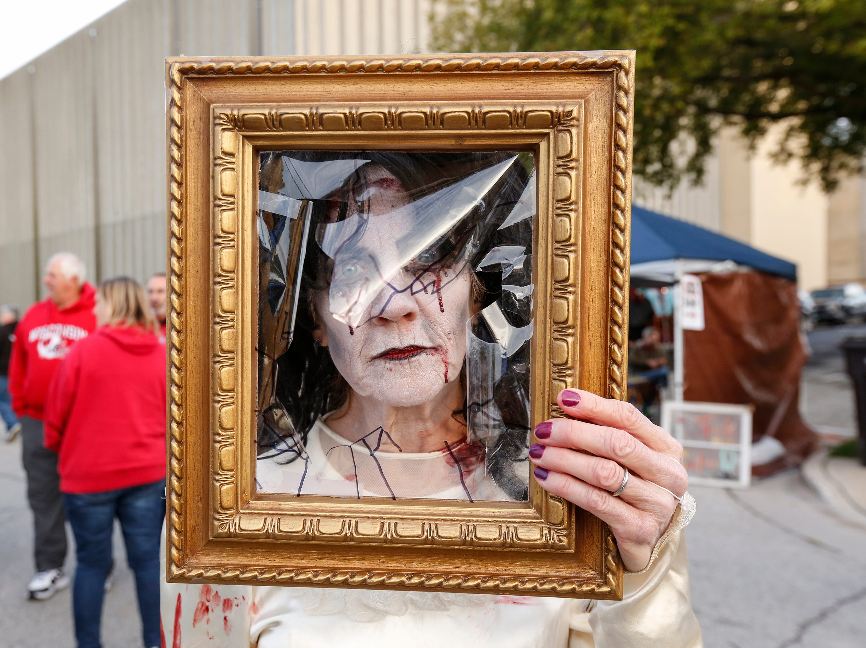 Bobbie Novak dressed as Bloody Mary poses for a picture during Windigo Fest Saturday, Oct. 6, 2018, in Manitowoc, Wis.