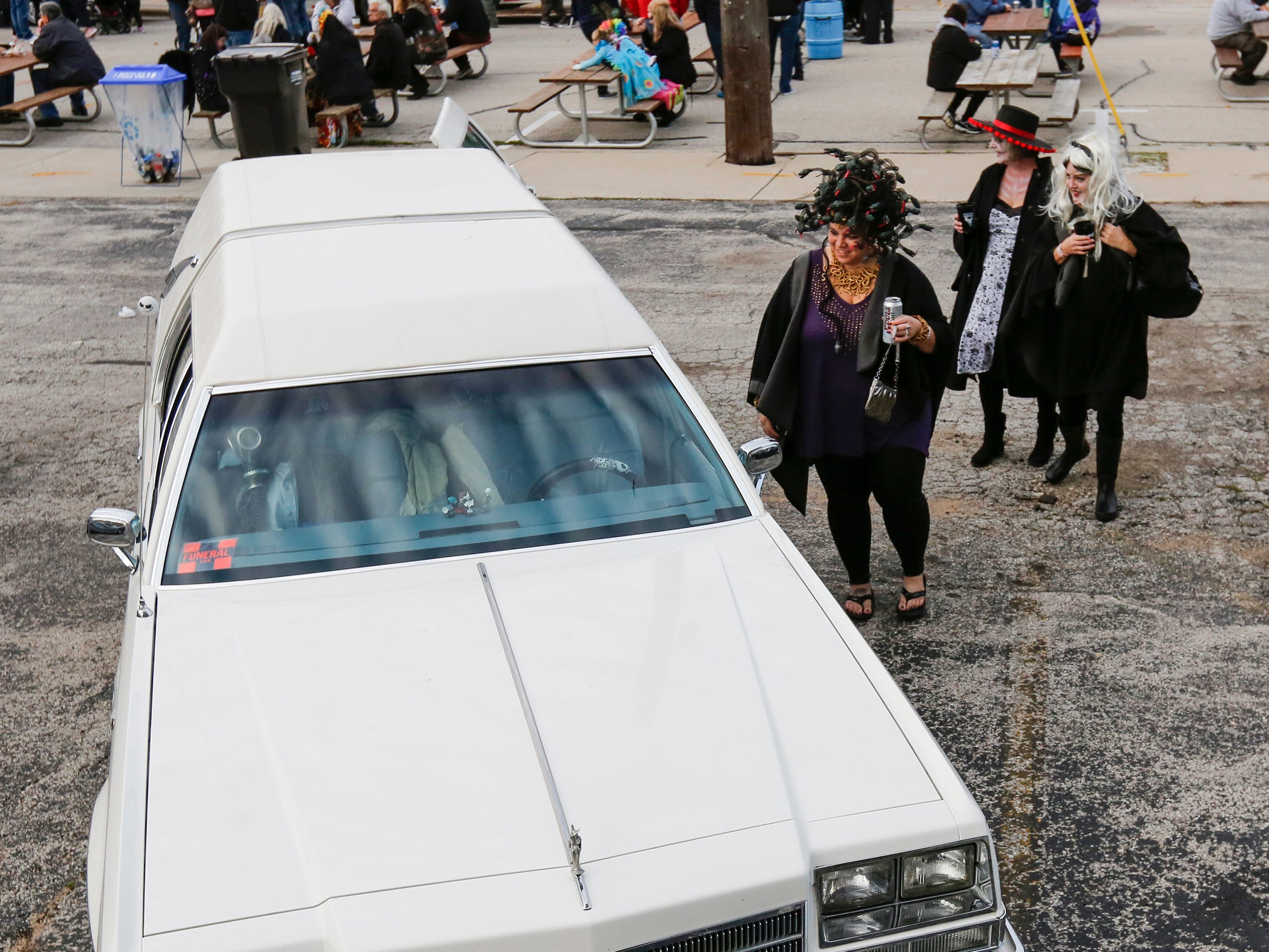 People look at a hearse on display during Windigo Fest on Saturday, Oct. 6, 2018, in Manitowoc, Wis.