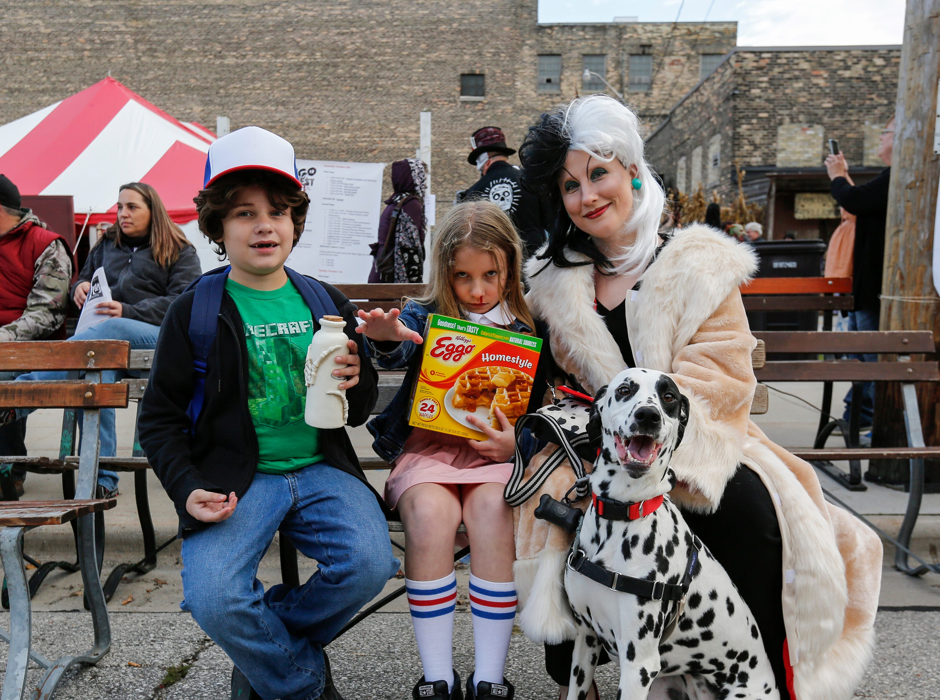 Jillian, 11, and Jakob, 8, pose with their mom Sara Hoffmann in costume during Windigo Fest on Saturday, Oct. 6, 2018, in Manitowoc, Wis.