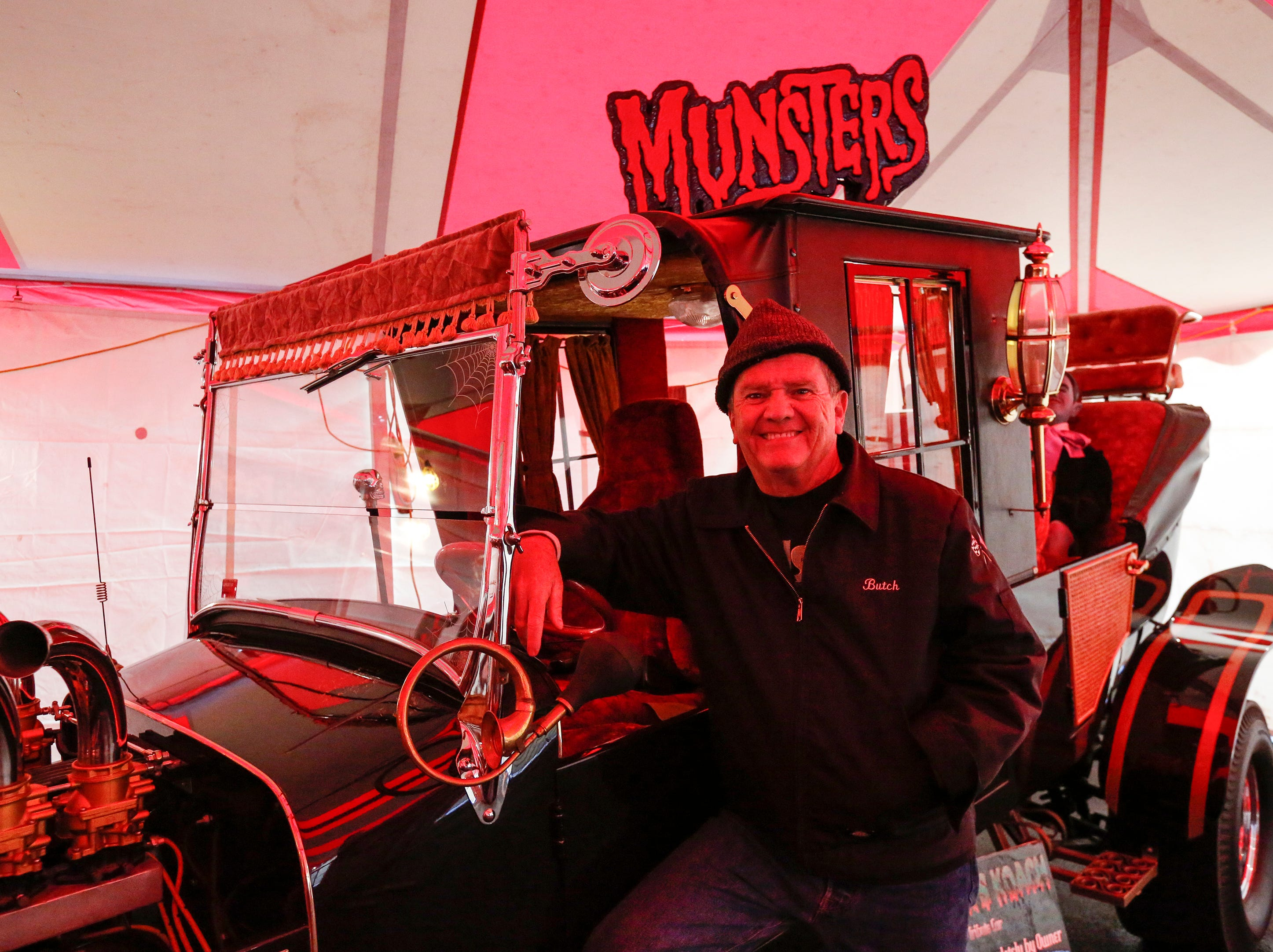 "Former child actor Butch Patrick poses near a car from ""The Munsters"" during Windigo Fest on Saturday, Oct. 6, 2018, in Manitowoc, Wis."