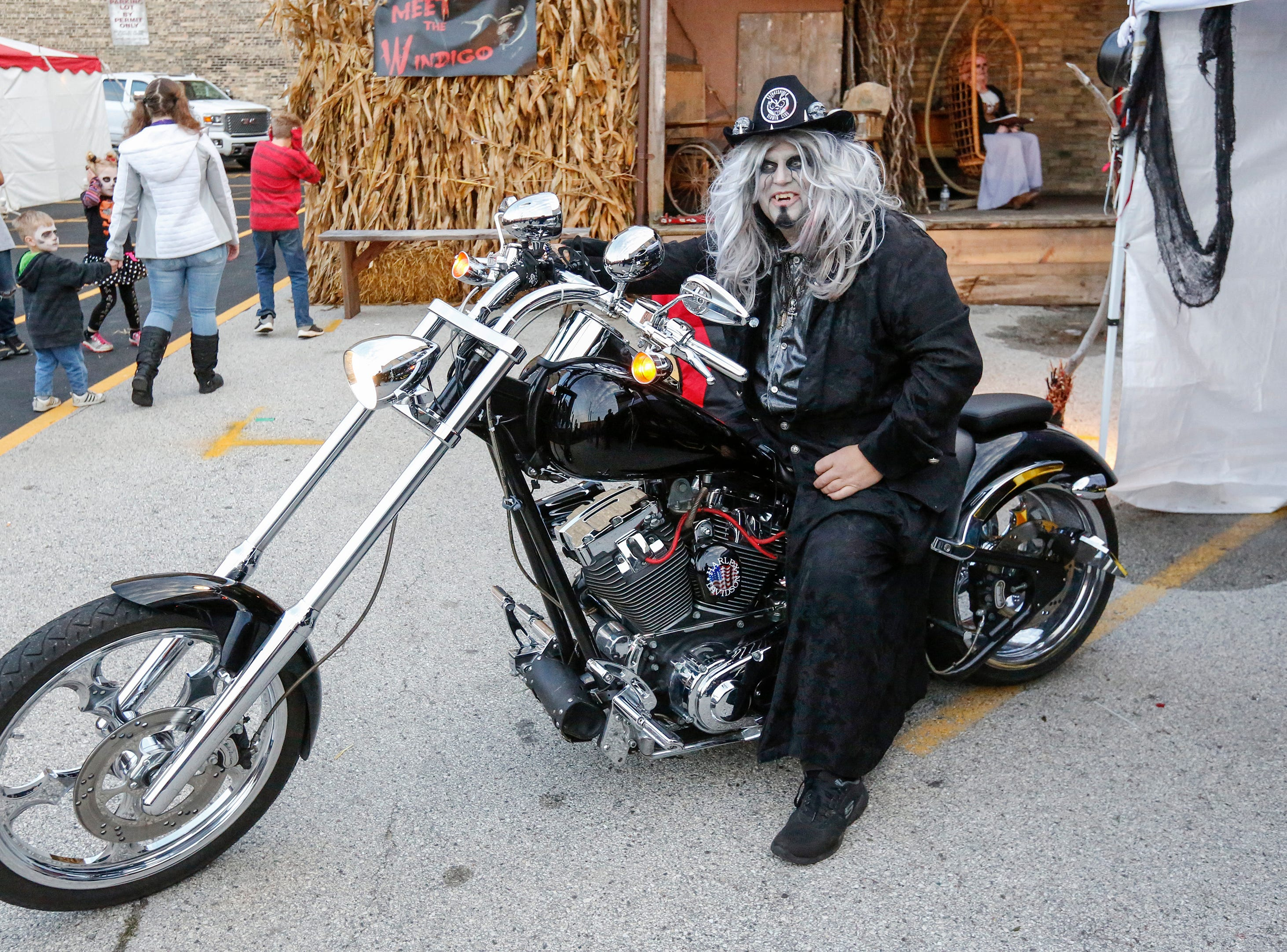 Deadgar Winter revs his motorcycle during Windigo Fest on Saturday, Oct. 6, 2018, in Manitowoc, Wis.