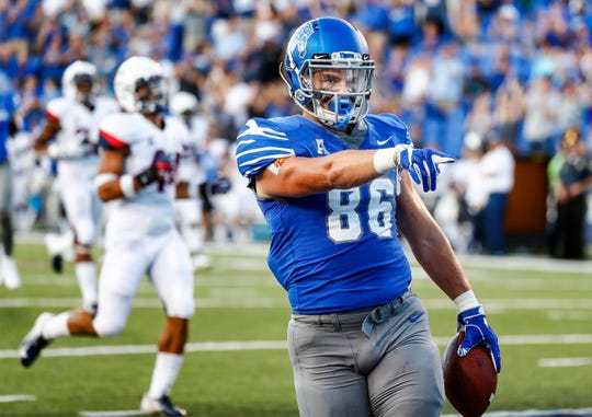 Memphis tight end Joey Magnifico celebrates a touchdown against the UConn defense during action in Memphis, Tenn., Saturday, October 6, 2018.