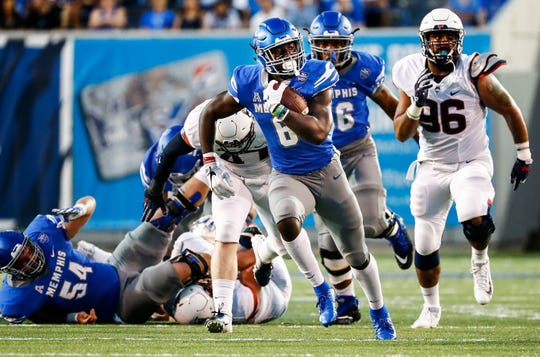 Memphis running back Patrick Taylor Jr. (middle) runs past the UConn defense during action in Memphis, Tenn., Saturday, October 6, 2018.