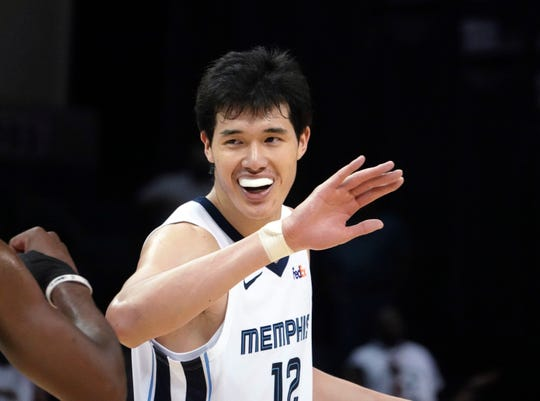 Memphis Grizzlies' Yuta Watanabe (12) is congratulated by teammates during the second half of a preseason NBA basketball game against the Indiana Pacers on Saturday, Oct. 6, 2018, in Memphis, Tenn. The Grizzlies won in overtime, 109-104.