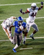 Memphis running back Patrick Taylor Jr. (bottom) runs past the UConn defense for a touchdown during action in Memphis, Tenn., Saturday, October 6, 2018.