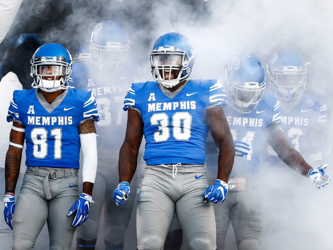 Memphis's Alec Long (middle) takes the field before taking on UConn in Memphis, Tenn., Saturday, October 6, 2018.