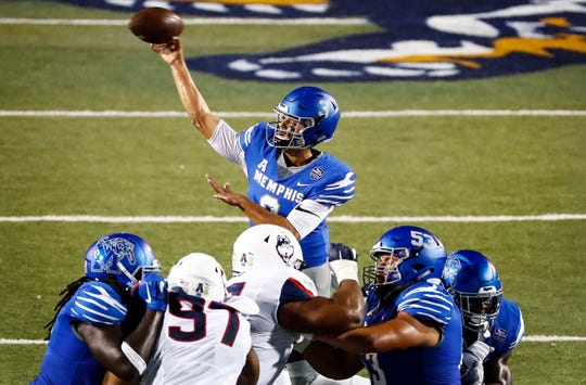 Memphis quarterback Brady White makes pass during action against UConn in Memphis, Tenn., Saturday, October 6, 2018.