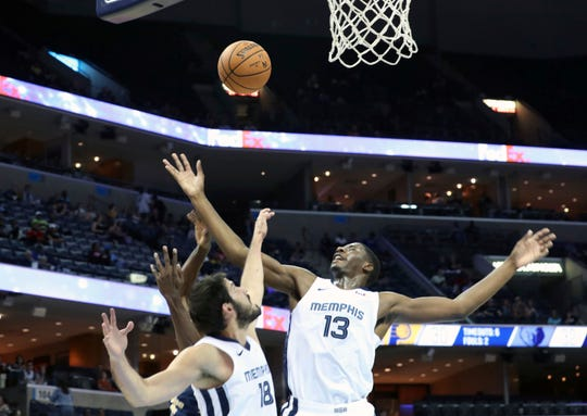 Memphis Grizzlies Jaren Jackson Jr. (13) and Omri Casspi (18) reach for the ball in the first half of a preseason NBA basketball game against the Indiana Pacers, Saturday, October 6, 2018, in Memphis.