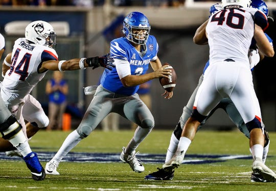 Memphis quarterback Brady White (middle) during action against UConn in Memphis, Tenn., Saturday, October 6, 2018.