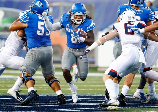 Memphis running back Darrell Henderson (middle) runs past the UConn defense during action in Memphis, Tenn., Saturday, October 6, 2018.