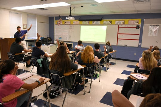 John Whitcomb's algebra class contains a mix of grade levels. Everglades City School, a linchpin of the town, contains all grades from pre-kindergarten to high school senior on one campus.