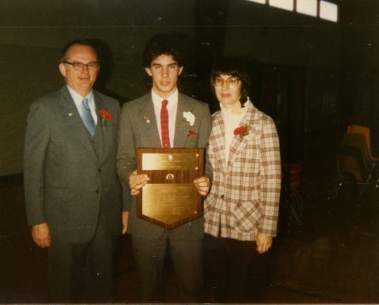 Scott Walker poses with his father, Llewellyn, and mother, Patricia. Scott holds a plaque from Boys Nation, a trip where boys learn about government.