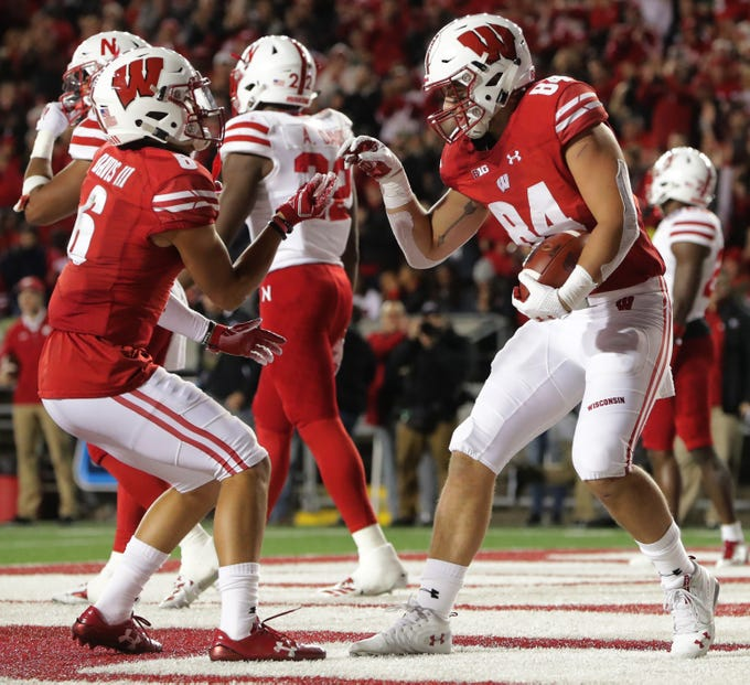 Tight end Jake Ferguson (right) celebrates his 14-yard touchdown reception in the second quarter with Danny Davis during the Badgers' game against Nebraska on Saturday night at Camp Randall Stadium.