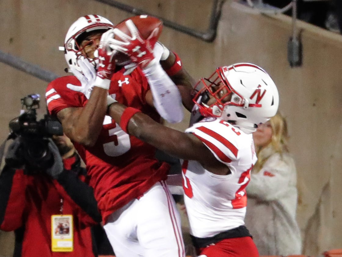 Wisconsin wide receiver Kendric Pryor is unable to stay in bounds while making a catch against Nebraska cornerback Dicaprio Bootle during the first quarter Saturday night.