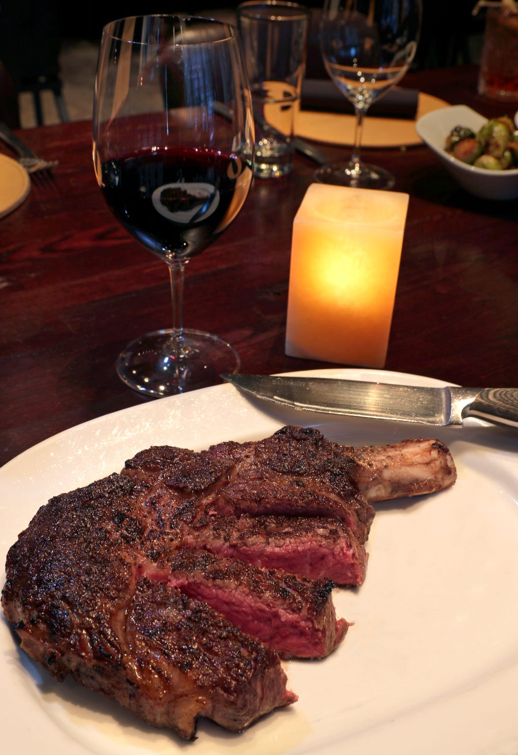 A perfectly cooked steak, like this 20-ounce, wet-aged, bone-in rib-eye, is the hallmark of  Carnevor,  718 N. Milwaukee St.