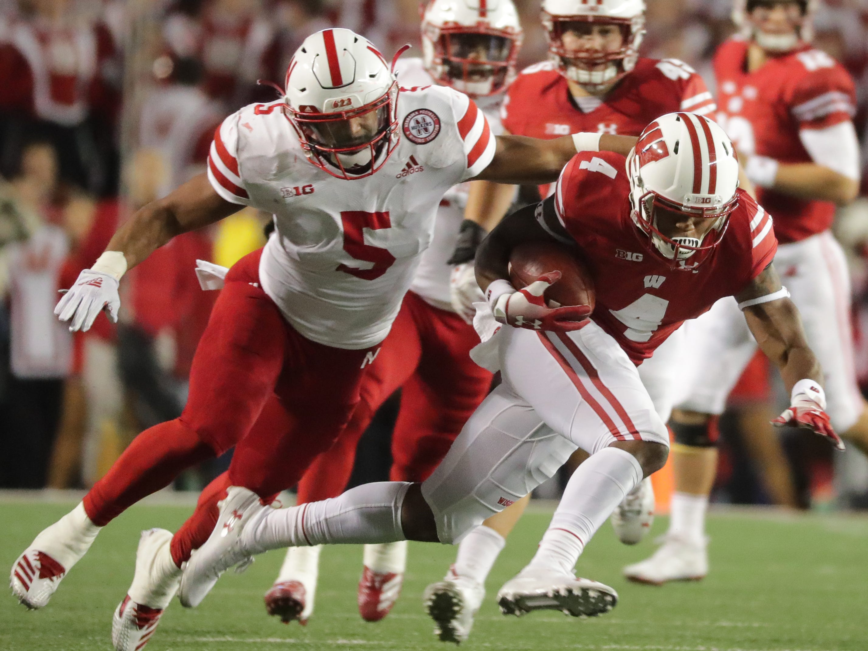 Wisconsin wide receiver A.J. Taylor picks up a first down on a 14-yard reception during the second quarter against Nebraska on Saturday night.